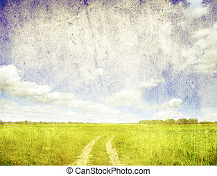 field  - grunge image of green field and blue sky