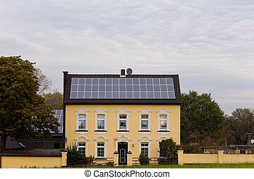 Historic house with solar panels on roof - Historic house...