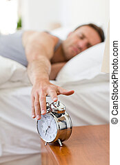Man waking up in his bed