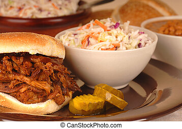Pulled pork sandwich with cole slaw and beans - A pulled...