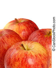 Four organic gala apples with a shallow depth of field isolated on white