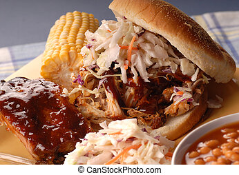 Pulled pork sandwich with cole slaw, beans and corn
