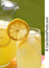 Pitcher and glass of lemonade - A pitcher and a glass of...