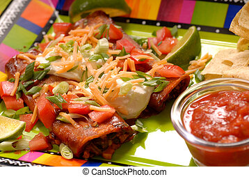 Enchiladas with tortilla chips and salsa