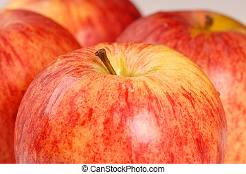 Four gala apples with a shallow depth of field