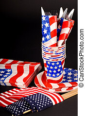 A 4th of July tablesetting with cups, napkins, flags and silverware