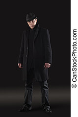 Man in black cloth stand - studio shot