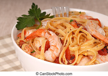 Close up of a bowl of linguine with shrimp
