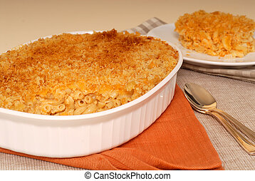 Casserole of macaroni and cheese with a piece cut out - A...