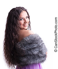 young girl with long hair in fur coat