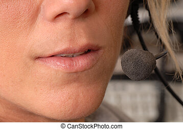 Close up of police dispatcher's mouth - A close up of a...