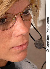 Close up of a police dispatcher's face - A close up of a...