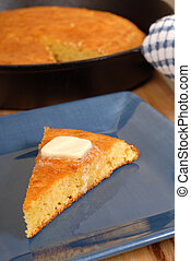 Slice of cornbread with melting butter