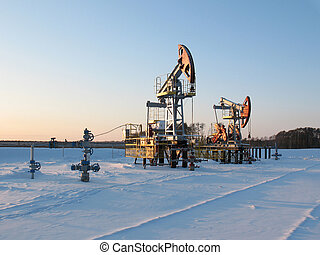Extraction - Oil pump jack in work. Oil industry in West...