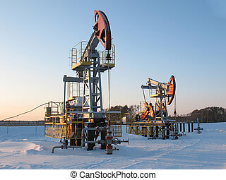Extraction 4 - Oil pump jack in work. Oil industry in West...