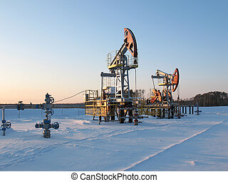 Extraction 2 - Oil pump jack in work. Oil industry in West...