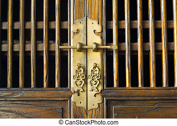 Old traditional Chinese door with beautiful metal decoration