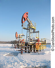 Oil pump jack 2 - Oil pump jack in work. Oil industry in...