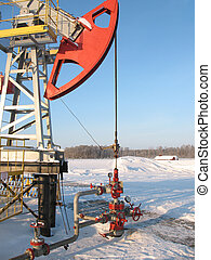 Oil pump jack 3 - Oil pump jack in work. Oil industry in...