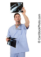 Young successful caucasian man doctor, x-ray - Young...