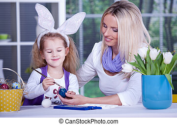painting of easter eggs - a girl painting the easter eggs...