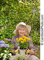 Retired woman working in the garden