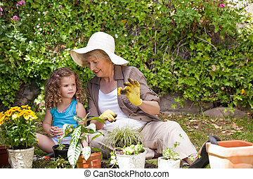 Happy Grandmother with her granddaughter working in the...
