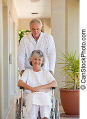Doctor with his patient in her wheelchair