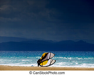 spirit of freedom - lonely kite surfer on the beach of...
