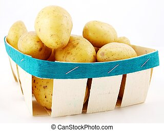Potatos - Fresh potatos with shell, in a basket towards...
