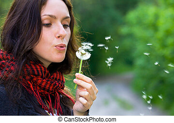 Girl with dandelion - Girl blowing on white dandelion in the...