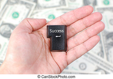 Success - Hand holding a computer enter key with the word...