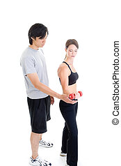 Asian man and Caucasian woman in work out clothing isolated on white.