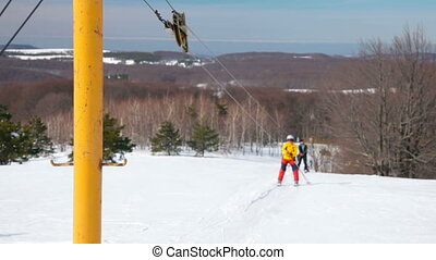 ski mountaineering - skiers being dragged by a ski lift,...