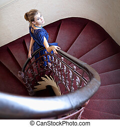 Classic portrait of elegant woman on staircase - Portrait of...