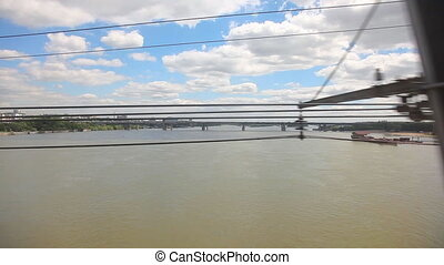 From train. - Bridge over river Ob through the window of an...