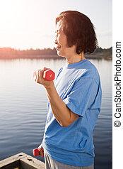 Senior asian woman exercise - A shot of a senior asian woman...
