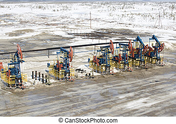 Oil pumps in West Siberia. Oil industry equipment