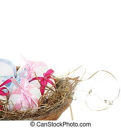 White Easter Eggs in Grass Nest