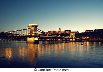 Chain Bridge, Royal Palace and Danube river in Budapest at...