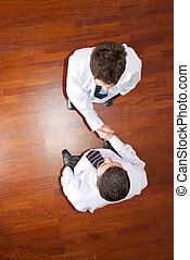 Business men handshake - Top view of two business men...