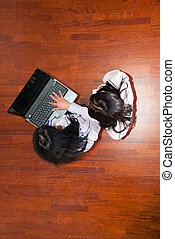 Top view of business women using laptop - Top view of two...