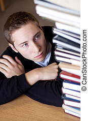 Stressed Student Looks At Books - A frustrated and stressed...