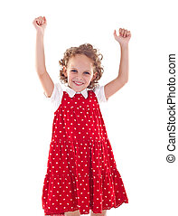 little girl wearing a red dress with her hands in the air
