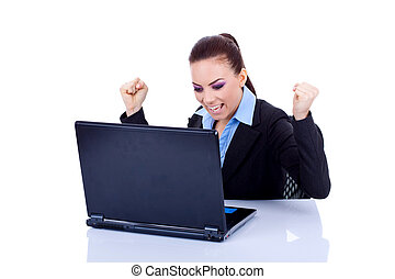 woman in office jubilates at desk - Young woman in office...