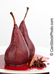 Poached pears in red wine with cinnamon and anise. Shallow...