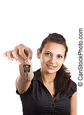 woman showing key in her hand, focus on the face