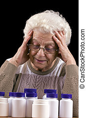 senior woman - Too many pills to take isolated in black...