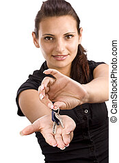 woman showing key in her hand, focus on the key