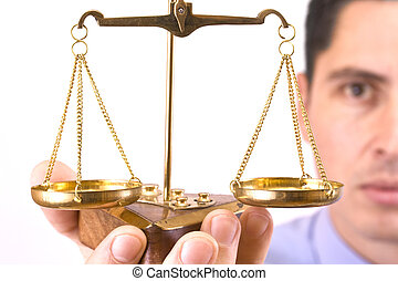 justice scale - A business man holding a justice scale,...